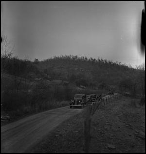 Primary view of object titled '[Mountain Funeral: Procession of Vehicles]'.