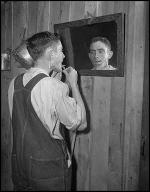 Primary view of object titled '[Gilbert Dove shaves for his wedding]'.