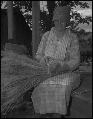 Primary view of object titled '[Aunt Nora Treece binding the broom]'.