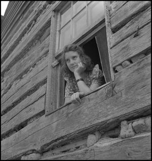 Primary view of object titled '[Hallie Mae Hopper in a window]'.
