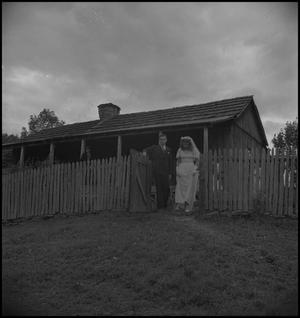 Primary view of object titled '[Gilbert Dove and Hazel Petrey leaving for the church]'.