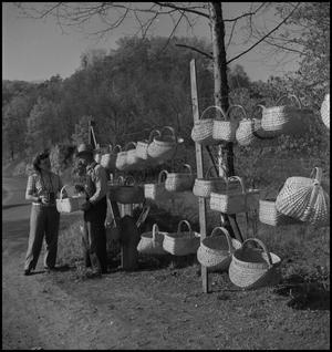 Primary view of object titled '[Wade Clark selling baskets]'.