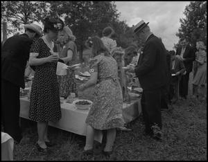 Primary view of object titled '[Wedding Guests in line for Food]'.