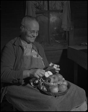 Primary view of object titled '[Cutting apples]'.