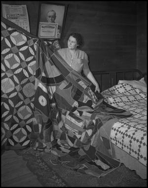 Primary view of object titled '[Grandma Iris Clark showing quilts]'.