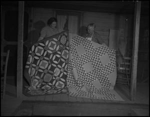 Primary view of object titled '[Iris Clark and Nora Treece showing quilts]'.