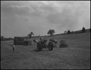 Primary view of object titled '[bailing hay]'.