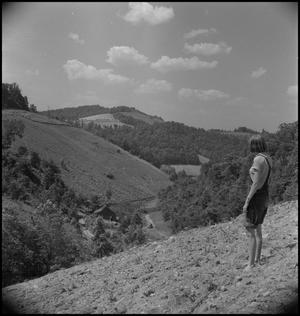 Primary view of object titled '[Hallie Mae Hopper looking out to the hills]'.