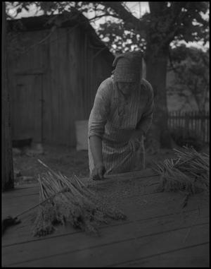 Primary view of object titled '[Aunt Nora Treece making a broom]'.