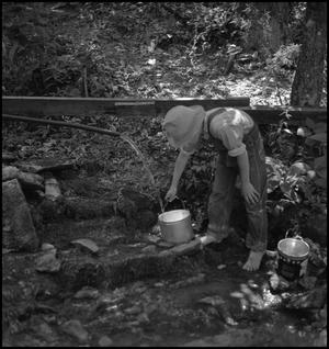 Primary view of object titled '[Fetching Water From a Spout]'.