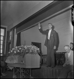 Primary view of object titled '[Mountain Funeral: Reverend Gives Sermon]'.