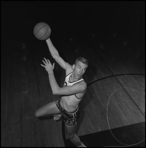 Primary view of object titled '[Dave Ebershoff jumping with a basketball]'.