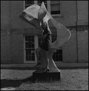 Primary view of object titled '[Jackie Barret posing with a sculpture]'.