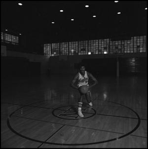Primary view of object titled '[Carl Jones holding a basketball]'.