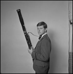 Primary view of object titled '[Concert band musician and tour member with bassoon]'.