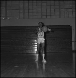Primary view of object titled '[Wendel Hart passing a basketball]'.