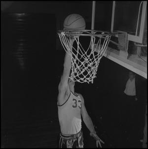 Primary view of object titled '[David Ebershoff Going to Dunk Basketball]'.