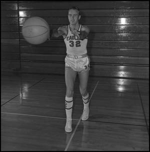 Primary view of object titled '[Mike Long passing a basketball]'.