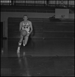Primary view of object titled '[Bubba Bailey in mid-dribble]'.