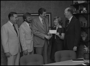 Primary view of object titled '[Representatives of Atlantic Richfield present a check to NTSU, May 12, 1978]'.