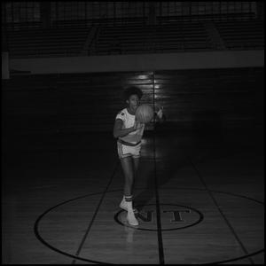 Primary view of object titled '[John Moody with a basketball]'.