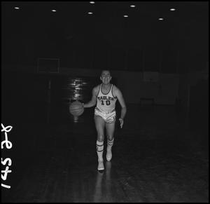 Primary view of object titled '[Billy Hughes dribbling a basketball, 2]'.