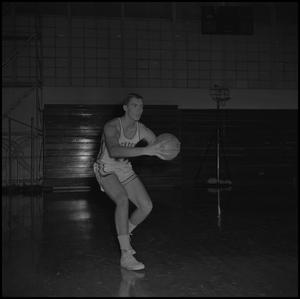 Primary view of object titled '[Bill Cutter holding a basketball]'.