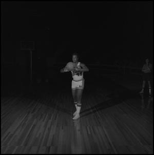 Primary view of object titled '[Palmo Simmons holding a basketball]'.