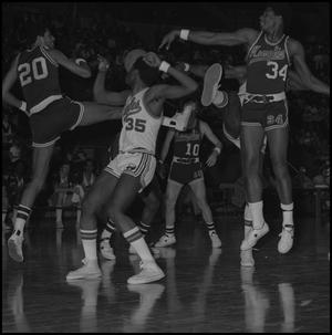 Primary view of object titled '[Men's Basketball Players North Texas Eagles vs Memphis State]'.