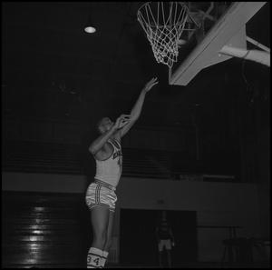Primary view of object titled '[Willie Davis Practicing Basketball]'.