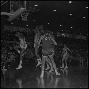 Primary view of object titled '[Basketball Player Shooting for the Hoop]'.