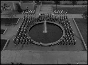 Primary view of object titled '[North Texas State University Marching Band in front of Willis Library]'.