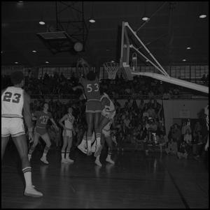 Primary view of object titled '[New Mexico State Basketball Player Throwing Ball]'.