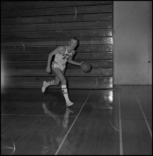 Primary view of object titled '[Bubba Bailey running along court]'.
