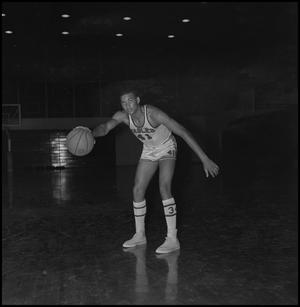 Primary view of object titled '[Willie Davis dribbling basketball]'.