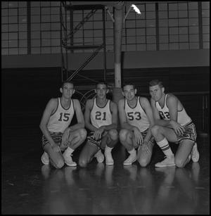 Primary view of object titled '[Four members of the 1960 basketball team]'.