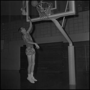 Primary view of object titled '[John Burks throwing up the basketball]'.