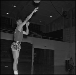 Primary view of object titled '[Doug Reedy throwing basketball]'.
