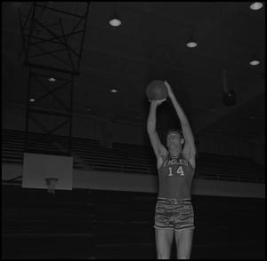Primary view of object titled '[John Jones holding up basketball]'.