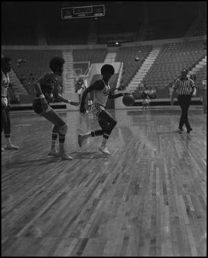 Primary view of object titled '[Basketball Players Running Along Court During Game]'.