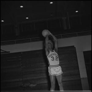 Primary view of object titled '[Matthew Huff shooting a basketball]'.
