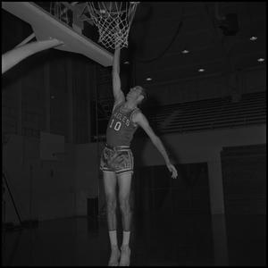Primary view of object titled '[Ted Barnes going to dunk basketball]'.
