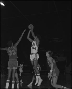 Primary view of object titled '[Eagles Basketball Player About To Toss Ball]'.