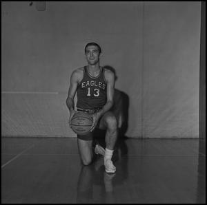 Primary view of object titled '[Dale Abshire kneeling with his basketball, 2]'.