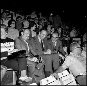 Primary view of object titled '[Football Game with members of NT Administration in stands, 1970s]'.