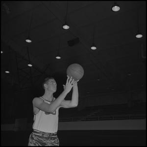 Primary view of object titled '[Bill Magers holding a basketball]'.