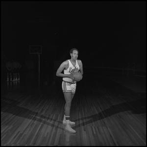 Primary view of object titled '[Kim Tate holding a basketball]'.