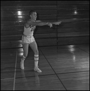 Primary view of object titled '[Billy Hughes passing a basketball]'.