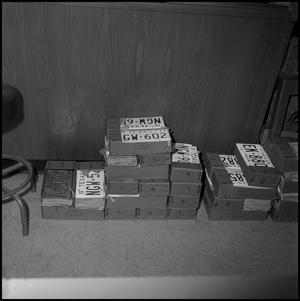 Primary view of object titled '[Boxes of license plates, 1973]'.