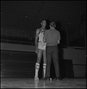 Primary view of object titled '[Willie Davis and Man, 2]'.
